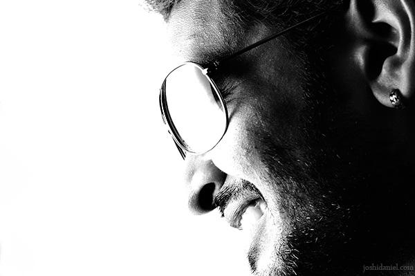 High-key portrait of male model Ajay J Nair smiling