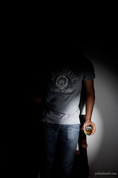 Portrait of male model Siddharth Reghunath holding whisky glass