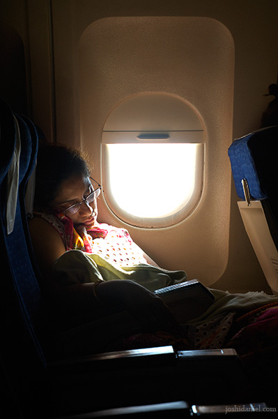 Candid portrait of a woman sleeping on board Air India flight