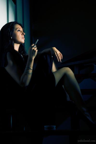 Portrait of a female model holding cigarette