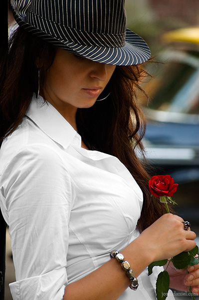 Portrait of a female model waiting with red rose