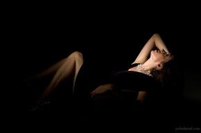 Fashion portrait of a female model in black dress