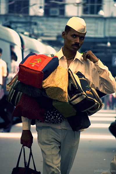 A dabbawala with tiffin boxes at Churchgate railway station, Mumbai, India