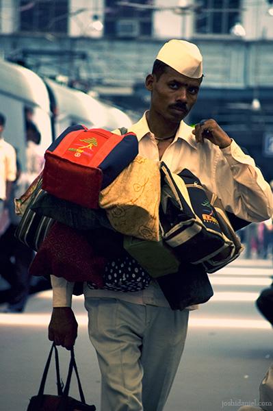 A dabbawala with tiffin boxes at Churchgate railway station, Mumbai, India