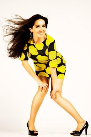 Fashion portrait of a female model in yellow dress