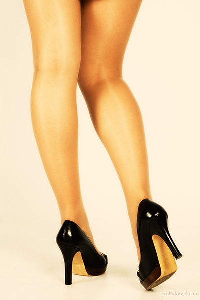 Bare legs of female model wearing high heels