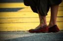 girl with tattooed leg waiting to cross the road in bukit bintang kuala lumpur malaysia