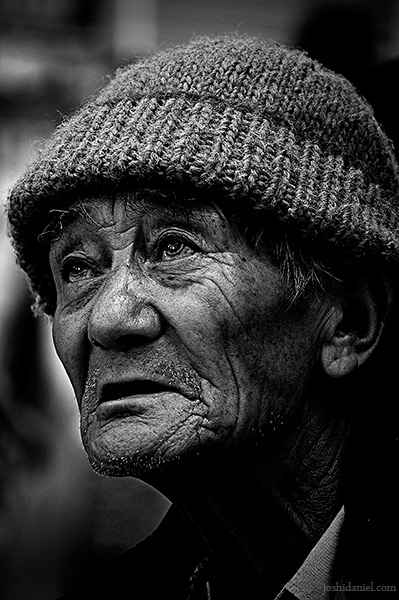 Black and white street portrait of an old man from Mcleod Ganj, Dharamsala