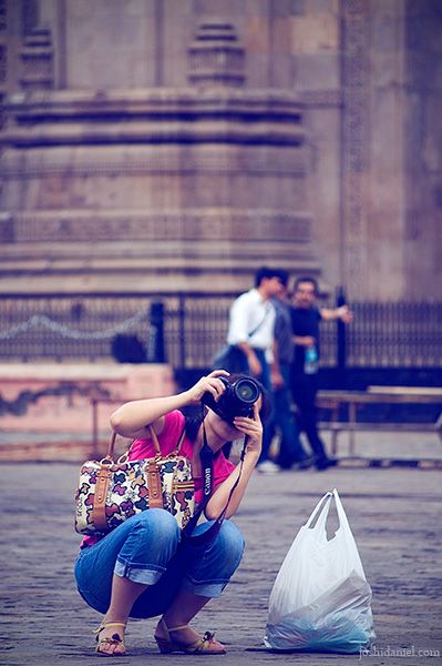A lady takes photographs in front of Gateway of India in Mumbai