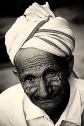 A mysterious smile portrait of an old man with wrinkled face from Mcleod Ganj, Dharamsala, India