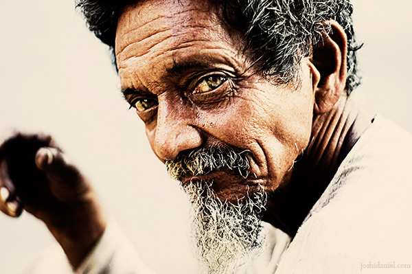 Captivating eyes of a banana seller from the streets of Mumbai, India