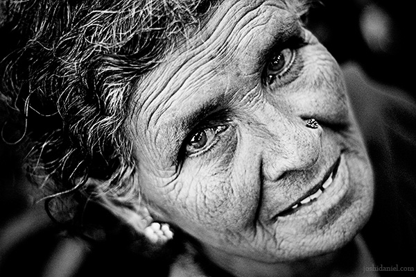A rose seller as sparkling as her eyes from Dadar flower market, Mumbai, India