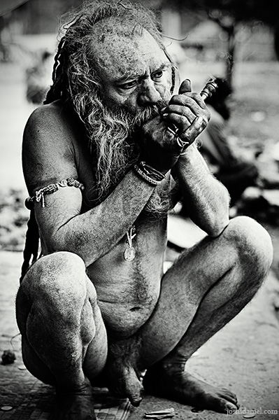A naga sadhu smoking chillum during the Kumbh Mela 2010 in Haridwar