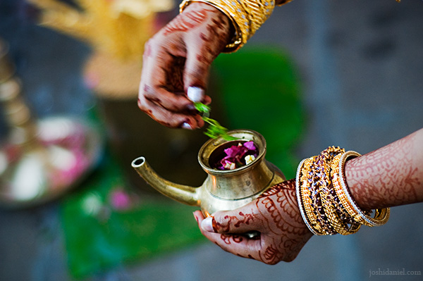 Bride Chandini Madhavan performing a ritual from a South Indian wedding