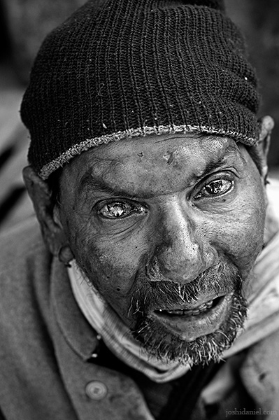 Black and white portrait of a man from the streets of Haridwar, India
