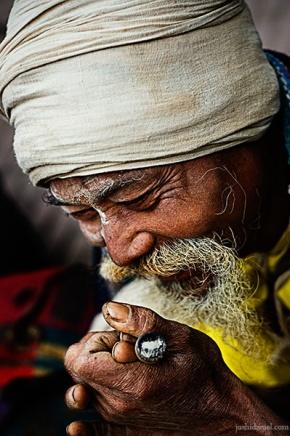 Smile of a sadhu with chillum during Kumbh Mela 2010 in Haridwar