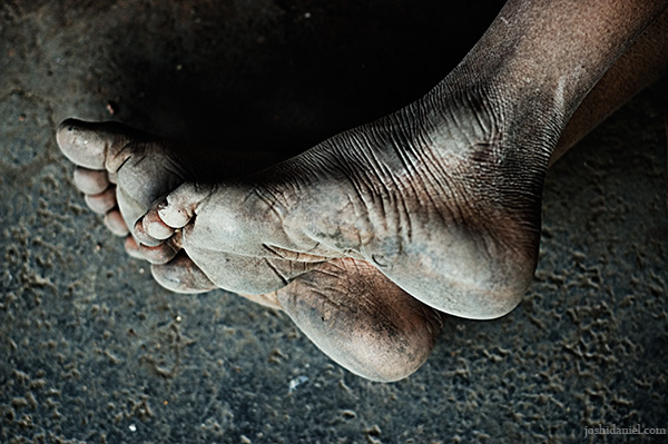 Feet of a young boy who was sleeping in the platform of Dadar railway station in Mumbai, India