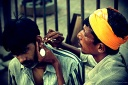 a traditional ear cleaner at work in streets of bandra in mumbai