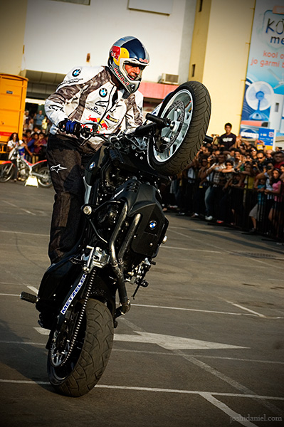 Chris Pfeiffer doing a wheelie on his BMW F 800 R during the redbull chris pfeiffer India tour in Mumbai