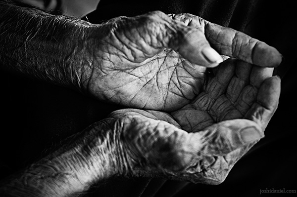 Hands of an old man in agony from Andheri station in Mumbai