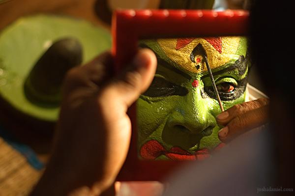 Reflection of kathakali artist kalamandalam Ratheesan doing make-up