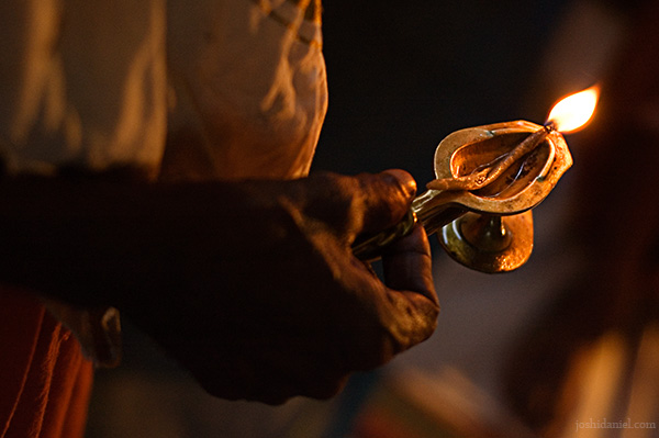 Man holding an oil lamp