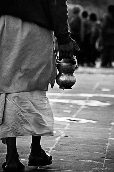 A pilgrim carrying holy water from ganga during kumbh mela 2010 in Haridwar
