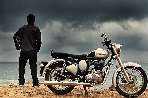 A biker standing near his royal enfield classic 350 enjoying a solitary moment