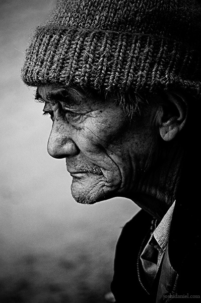 Pensive black and white portrait of an old man form Mcleod Ganj
