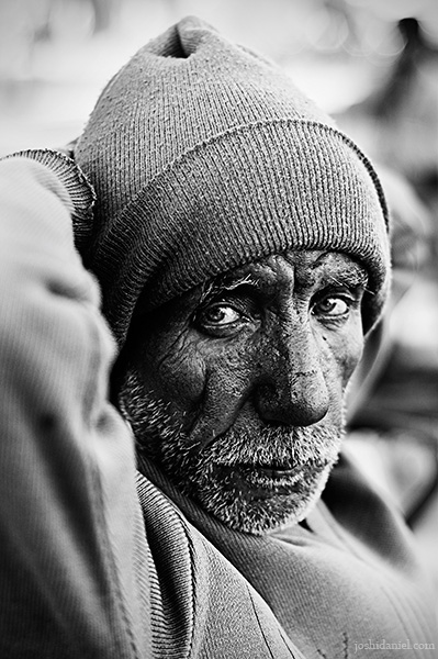 Black and white portrait of a rickshaw wallah from Jaipur, Rajasthan