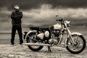 anuroop nair with his royal enfield classic 350 on a cloudy day