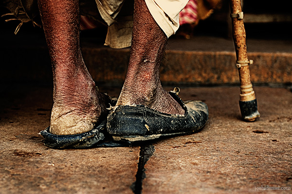 Feet of a man in worn out shoes in Jaisalmer