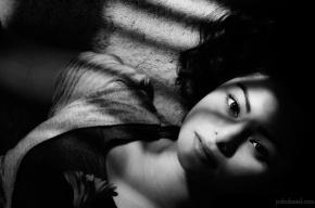 Portrait of Konkana Bakshi lying on the floor