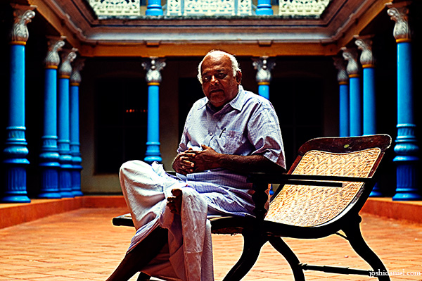 Chandramodi Chettiar sitting at the courtyard of his Chettinadu Manision