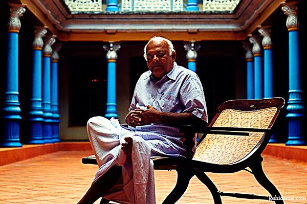 Chandramodi Chettiar sitting at the courtyard of his Chettinadu Manision