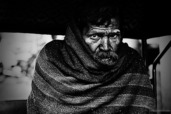 Portrait of a rickshaw wallah on a chilly day in Jaipur, Rajasthan