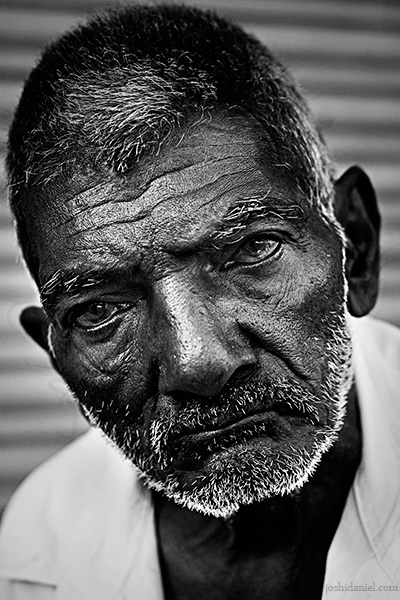Black and white portrait of an old man from Chala market, Trivandrum