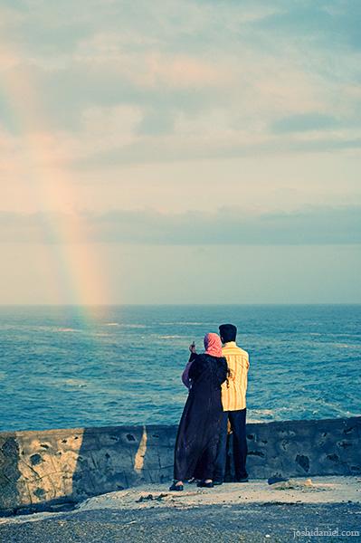 Couple watching rainbow at Vizhinjam, Kerala, India