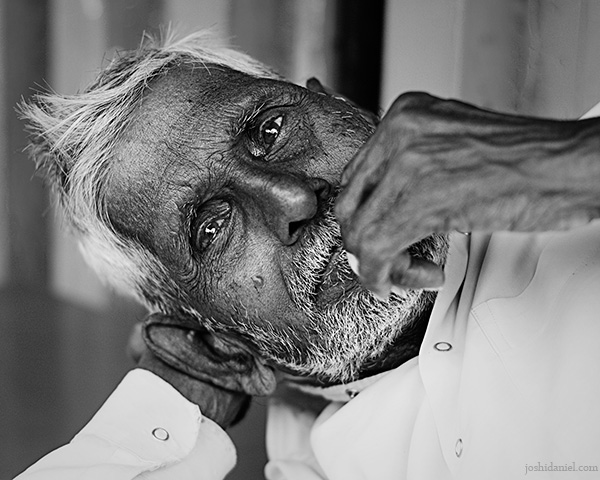 Laid back black and white portrait of an old man from Pune