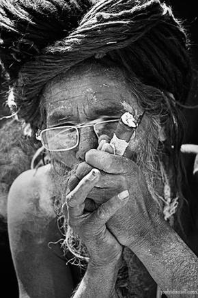 A naga sadhu smoking chillum during the kumbh mela 2010 in haridwar