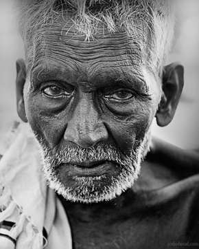 Black and white street portrait of an old man from Tamil Nadu, India