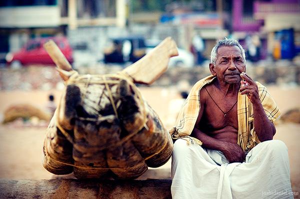 A fisherman sitting near a catamaran at Shankhumugham, Trivandrum