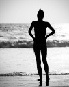 Silhouette of a tourist girl from Kovalam beach in Kerala