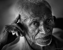 Black and white portrait of a an old man from Fort Kochi in Kerala, India