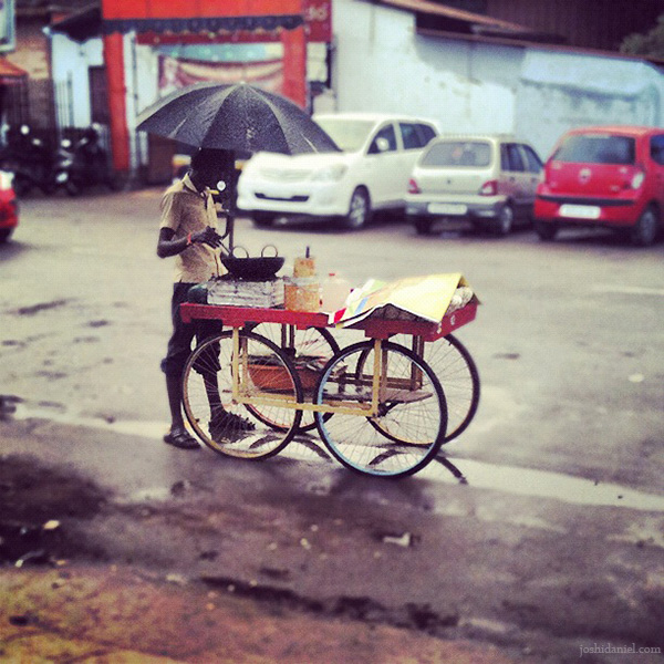 Peanut seller on a rainy day at Trivandrum in Kerala, India