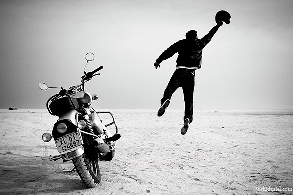 A biker jumping near his Royal Enfield classic 350 in Trivandrum