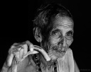 Black and white portrait of an old man from Karnataka holding a walking stick