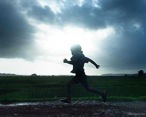A running boy on a cloudy day from Kumta in Karnataka