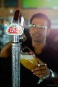 A bartender filling the glass with Stella Artois from tap at Courtyard by Marriott Dubai