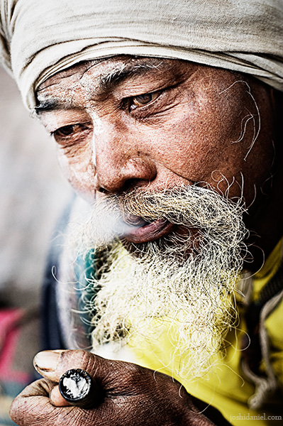 Sadhu smoking chillum during the kumbh mela 2010 in Haridwar
